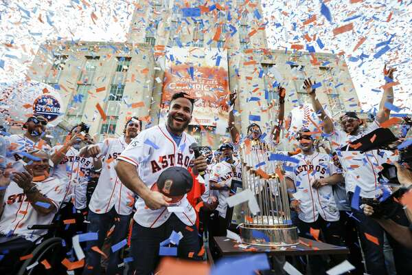 Houston Astros second baseman Jose Altuve tosses a World Series cap into the crowd during the Astros World Series championship celebration rally at City Hall on Friday, Nov. 3, 2017, in Houston.