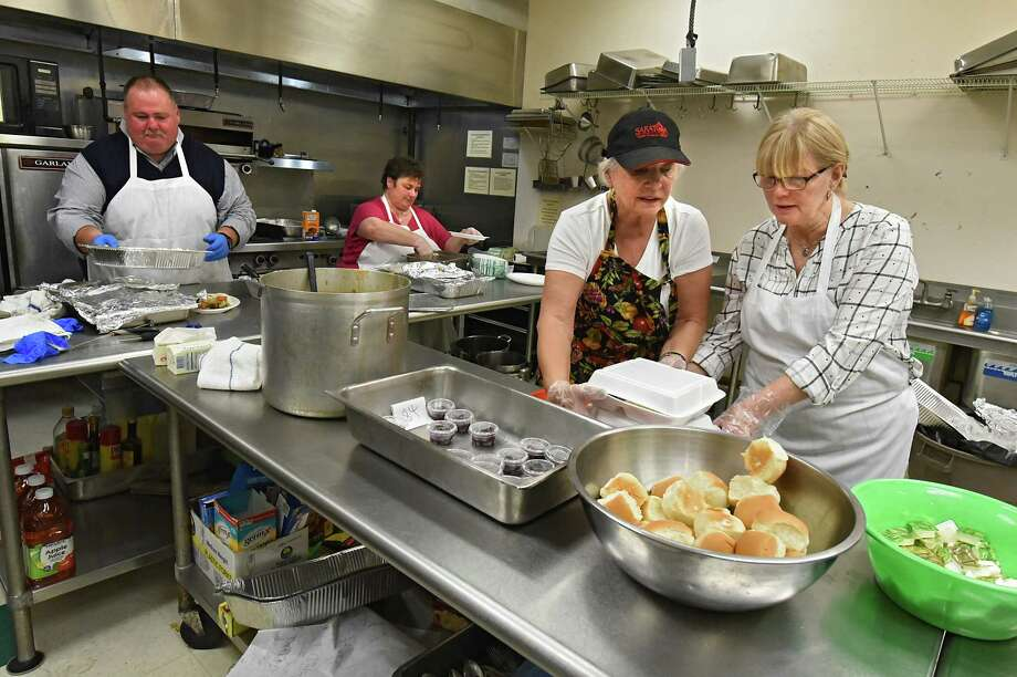 Volunteers work in the kitchen to help serve a special Thanksgiving holiday dinner to seniors as part of the fledgling seniors program at Hibernians Hall on Thursday, Nov. 16, 2017 in Schenectady, N.Y. (Lori Van Buren / Times Union) Photo: Lori Van Buren, Albany Times Union / 20042156A