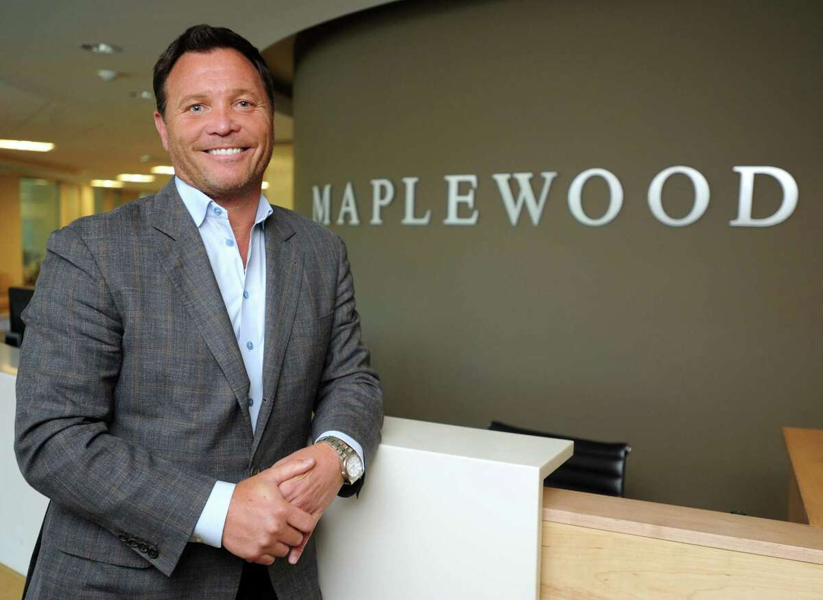 Greg Smith, chairman and CEO of Maplewood Senior Living, stands in the health care company's office in Westport, Conn., Wednesday, Aug. 19, 2015. The company just announced plans to develop a $246 million residence in Manhattan.