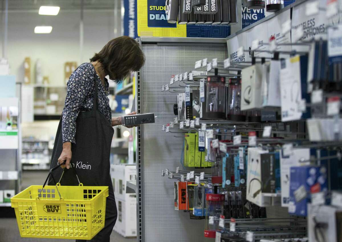 A woman browses through the wireless headphones isle at a Best Buy in Houston recently. The Richfield, Minnesota-based company's third-quarter results and outlook fell short of Wall Street expectations.