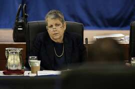 """FILE - In this May 18, 2017 file photo, University of California President Janet Napolitano listens as State Auditor Elaine Howle gives a presentation during a meeting of the University of California Board of Regents in San Francisco. Top advisers Napolitano improperly interfered in a state audit to tone down critical comments from campus administrators about the president's office, an investigation ordered by the UC regents found. The investigation finds that officials in the president's office instructed UC campuses not to """"air dirty laundry"""" to the state auditor, according to the San Francisco Chronicle, Wednesday, Nov. 15, 2017,, which reviewed the report ahead of its public release on Thursday. (AP Photo/Eric Risberg, File)"""
