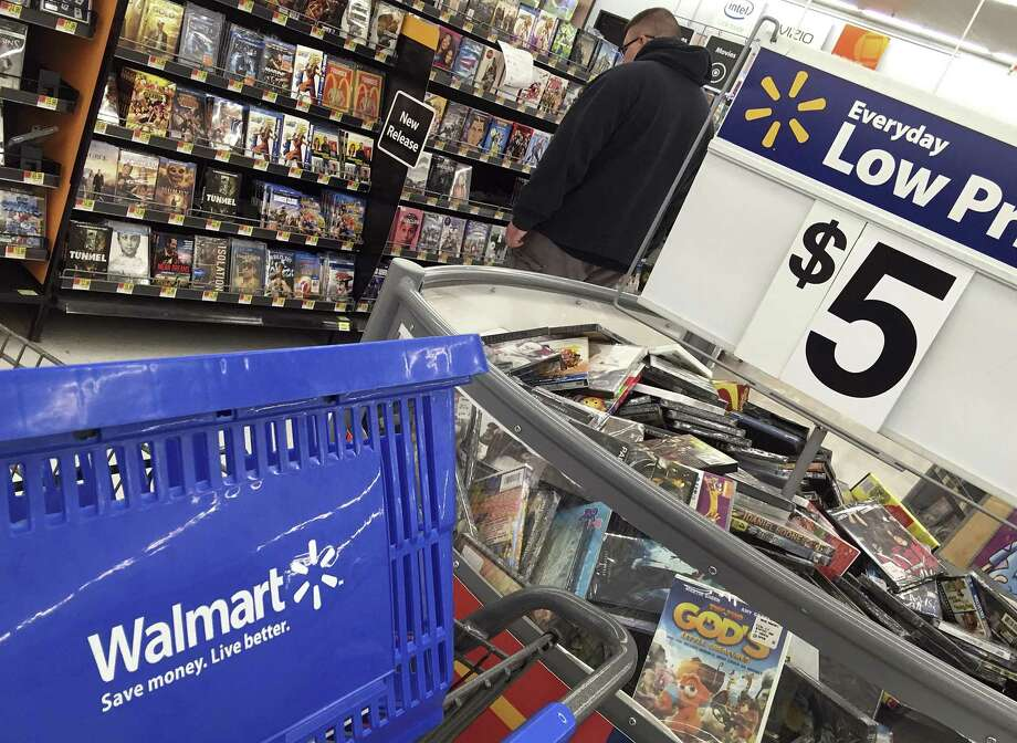 A shopper looks at merchandise at a Walmart in Salem, N.H. Overall, Walmart posted quarterly revenue of $123.18 billion, surpassing Wall Street forecasts of $121.05 billion. Photo: Elise Amendola /Associated Press / Copyright 2017 The Associated Press. All rights reserved.