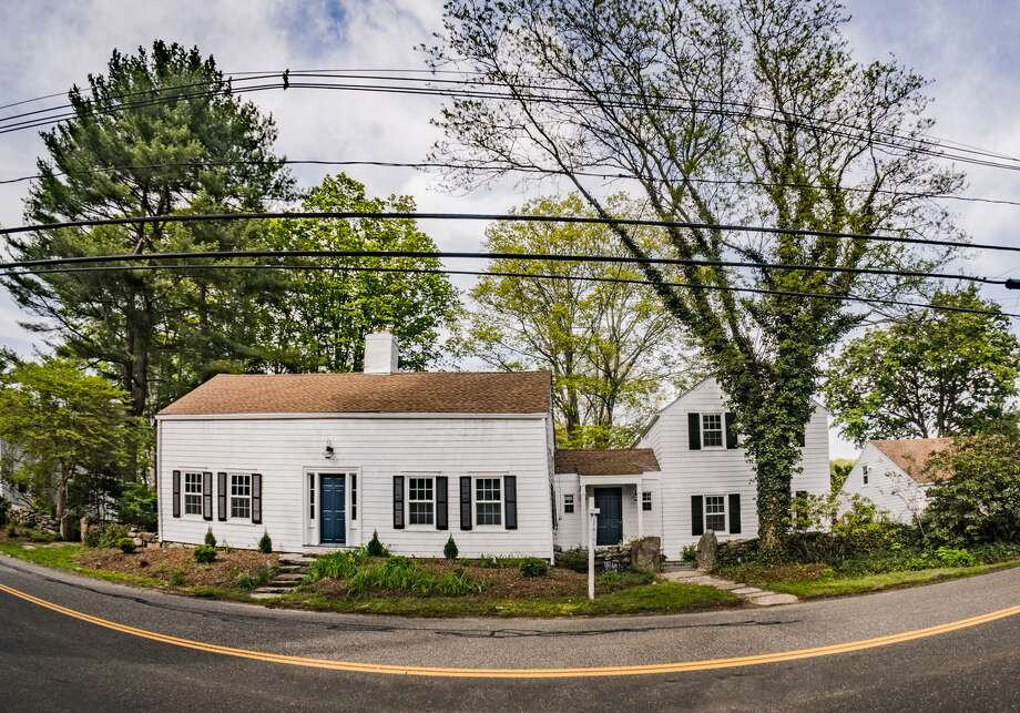 The antique colonial at 481 Old Long Ridge Road has four bedrooms and five bathrooms, and is listed at $924,900. Built in 1804, it's located in a historic section of Old Long Ridge Village in Stamford. Photo: Contributed Photo / Contributed Photo / Stamford Advocate Contributed