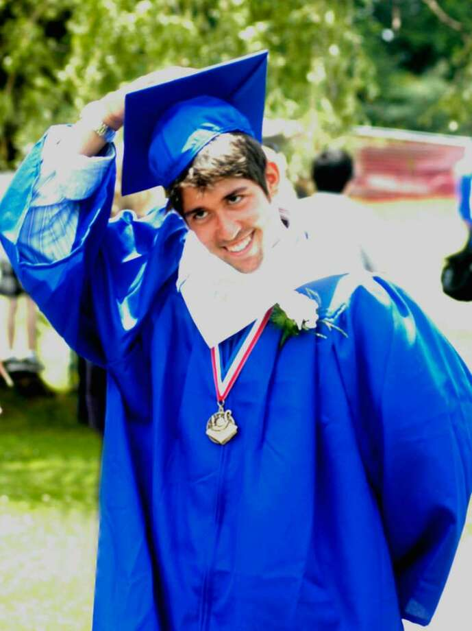 Samian Roy is already celebrant and hanging on to his hat as he marches in procession to Saturday's Shepaug Valley High School graduation on the school's rustic campus in Washington.  June 26, 2010 Photo: Norm Cummings / The News-Times
