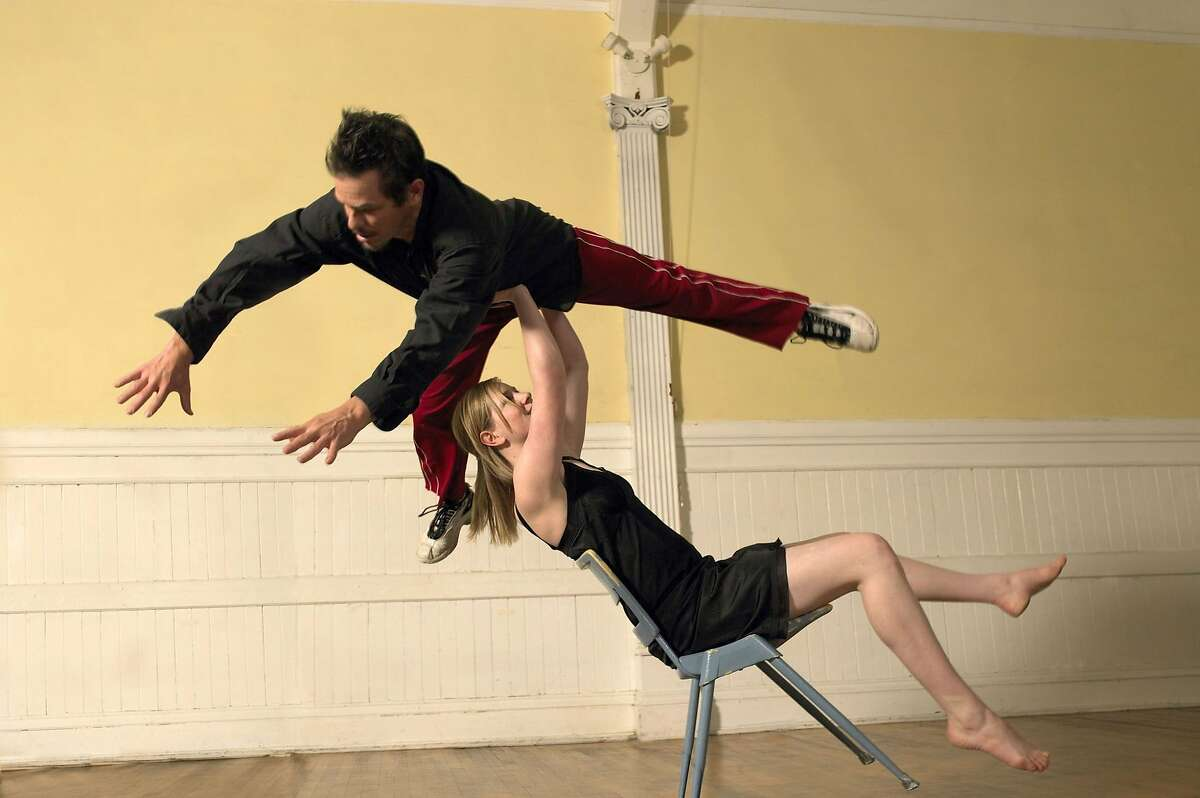 Scott Wells flies over the head of Lindsay Gauthier in Wells� inventive, athletic choreography. Wells makes a rare return to the stage for the 25th anniversary season of his company. Photo: David Papas.