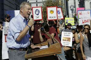 FILE - In this Oct. 24, 2017 file photo, Tom Steyer speaks at a rally calling for the impeachment of President Donald Trump in San Francisco. Steyer is doubling his spending on ads calling for Trump's impeachment to $20 million. (AP Photo/Jeff Chiu, file)