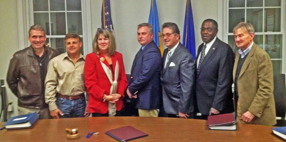 """The newly elected members of East Hampton's Town Council are, from left, Josh Piteo, Timothy Feegel, Melissa Engel, Mark Philhower, Kevin Reich, James """"Pete"""" Brown and Dean Markham. Photo: Jeff Mill / Hearst Connecticut Media"""