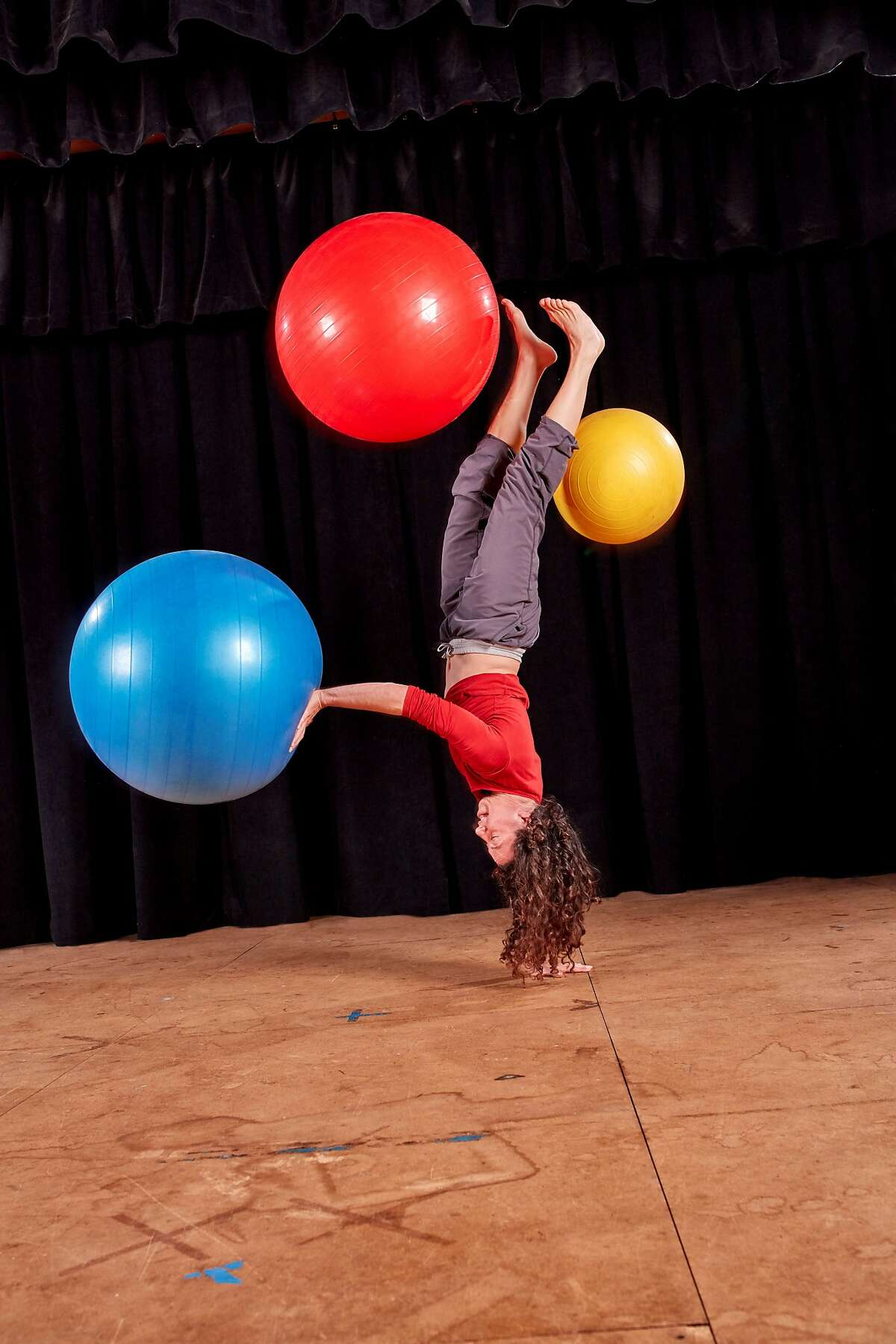 Shira Yaziv dances with Physioballs in �Ballistic,� one of Scott Wells�s signature acrobatic dance works. An updated version will be performed in Scott Wells & Dancers� 25th anniversary season at Dance Mission Theater. Photo: David Papas.