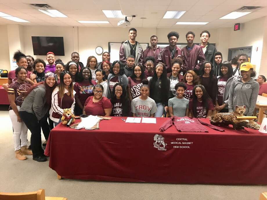 Central track star Maya Kelly signed with Troy University on Wednesday in the Austin Middle School library. (Photo provided by Eric Williams)