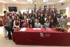Central track star Maya Kelly signed with Troy University on Wednesday in the Austin Middle School library.