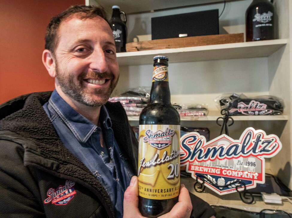 Jeremy Cowan of the Schmaltz Brewing Company shows off his Jewbelation beer that just last night won a Platinum award in an international beer competition Thursday Nov. 16, 2017 in Clifton Park, N.Y. (Skip Dickstein/ Times Union)