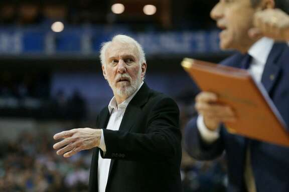 San Antonio Spurs head coach Gregg Popovich walks the sidelines during the second half of an NBA basketball game against the Dallas Mavericks in Dallas, Tuesday, Nov. 14, 2017. The Spurs won 97-91.