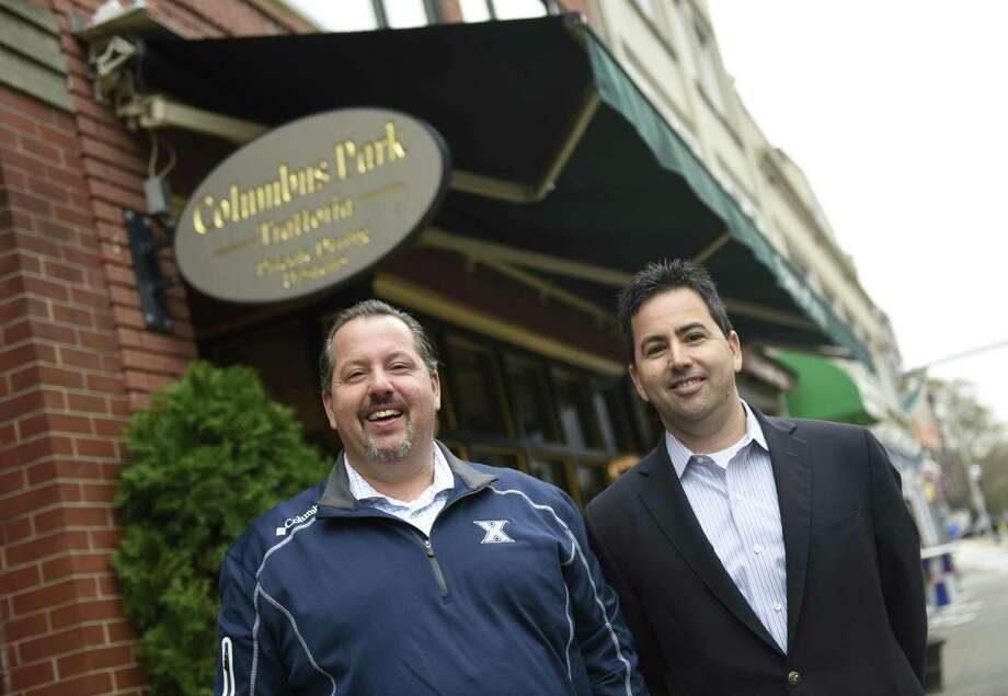 Brothers and co-owners Michael, left, and Frank Marchetti pose outside Columbus Park Trattoria at 205 Main St., in Stamford, Conn., on Tuesday, Nov. 14, 2017. The Italian restaurant is celebrating its 30th anniversary and has remained a staple of Main Street despite the area's many changes. Photo: Tyler Sizemore / Hearst Connecticut Media / Greenwich Time