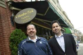 Brothers and co-owners Michael, left, and Frank Marchetti pose outside Columbus Park Trattoria at 205 Main St., in Stamford, Conn., on Tuesday, Nov. 14, 2017. The Italian restaurant is celebrating its 30th anniversary and has remained a staple of Main Street despite the area's many changes.