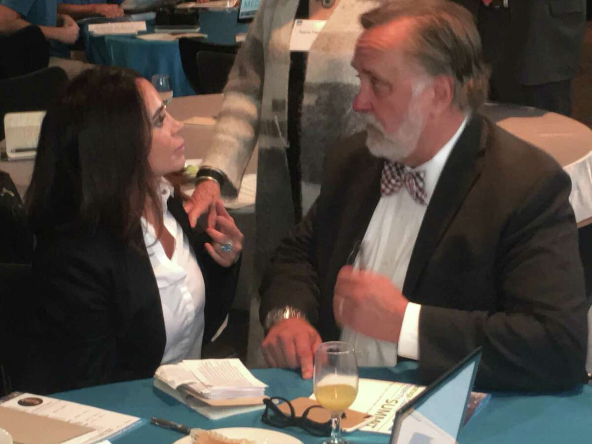 Marty Vanags, right, of the Saratoga County Prosperity Partnership, talks with Jodi Shelton, president of the Global Semiconductor Alliance after her keynote talk Thursday at the Saratoga County Prosperity Summit in Saratoga Springs.