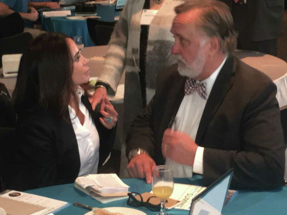 Marty Vanags, right, of the Saratoga County Prosperity Partnership, talks with Jodi Shelton, president of the Global Semiconductor Alliance after her keynote talk Thursday at the Saratoga County Prosperity Summit in Saratoga Springs. Photo: By Larry Rulison