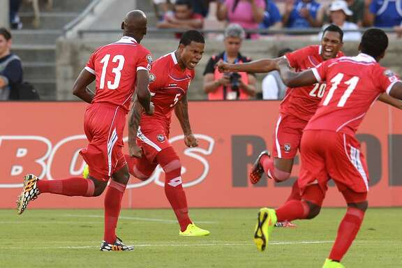 Panama's captain Roman Torres, 5, (2L) celebrates with teammates after scoring a goal in the early minutes against El Salvador's during their Central American Cup Tigo 2014 USA Third Place Match at the LA Memorial Coliseum in Los Angeles on September 13, 2014.   From left to right: Adolfo Machado, 13, Roman Torres, Roberto Nurse, 20, and Armando Cooper, 11.  AFP PHOTO / Robyn Beck        (Photo credit should read ROBYN BECK/AFP/Getty Images)