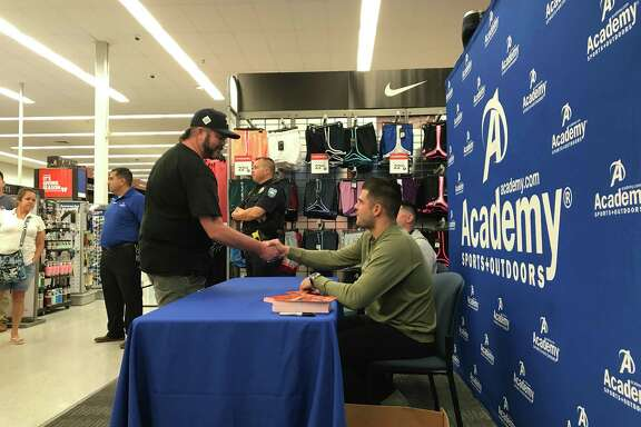 Billy Campbell thanks Lance McCullers Jr. for an autographed photo on Wednesday at the Academy in Pearland