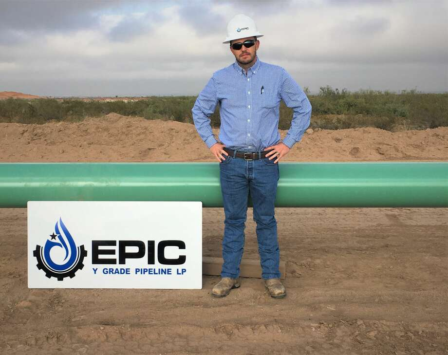 Justin Gordon, EPIC's senior vice president of Engineering and Operations, stands near pipes for the EPIC NGL Pipeline project. The construction is in Phase One, which is an area north of Orla. Photo: Photo Courtesy EPIC