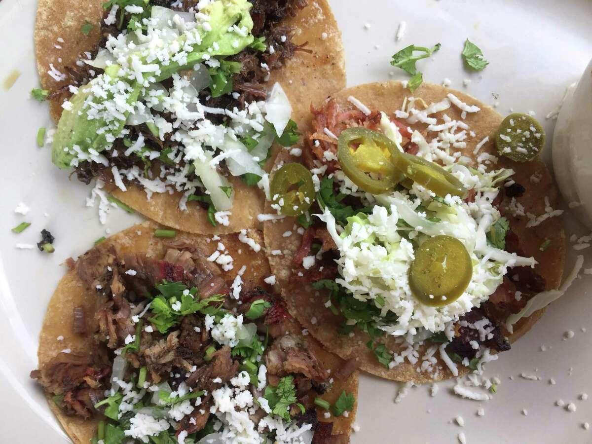 A trio of street tacos at La Taqueria Austin Hwy.