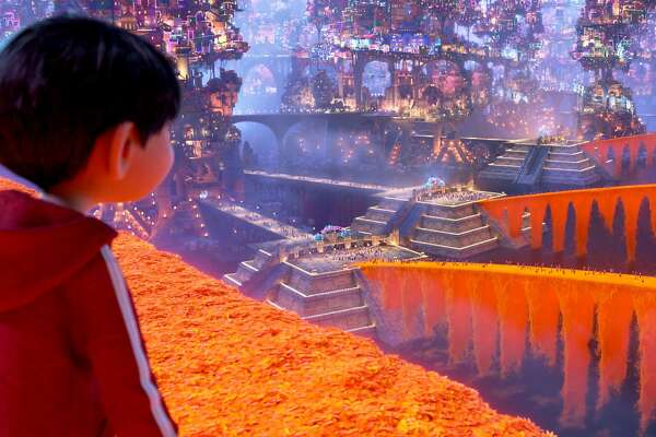 """In """"Coco,"""" Miguel finds himself in the Land of the Dead, featuring bridges of marigold petals. MUST CREDIT: Walt Disney Pictures-Pixar Animation Studios"""