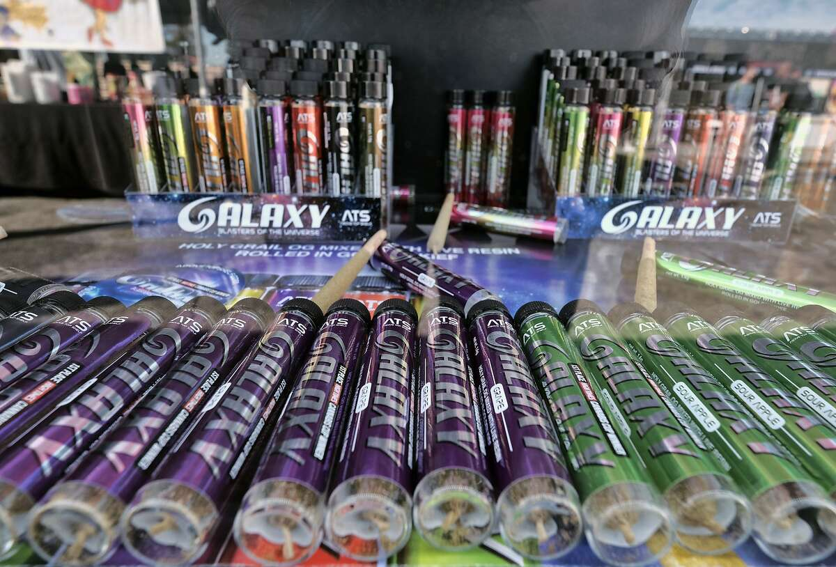 This Saturday, Nov. 11, 2017 photo shows pre rolled and marijuana cigarettes on display at he Galaxy companies booth during the High Times Harvest Cup in San Bernardino, Calif. The first time in Southern California, the Harvest Cup competition an extension of High Times' popular Cannabis Cup festival series, celebrated the best cannabis cultivated this season.