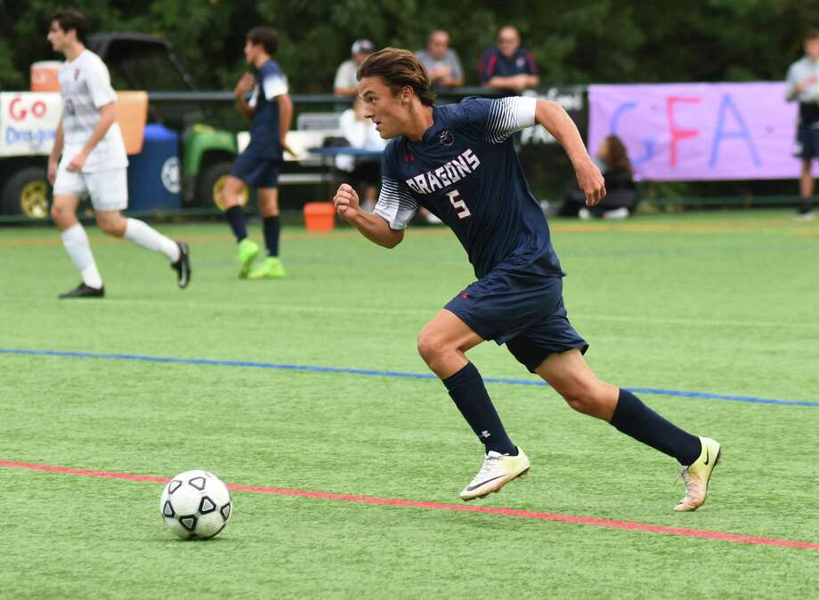 GFA's Liam Murphy pushes the ball up the field during a game earlier this season. The Dragons fell in the FAA semifinals to Masters (NY) 3-1 last Wednesday. Photo: Contributed Photo