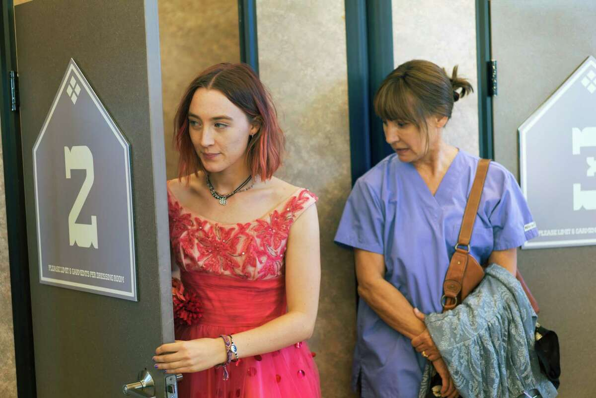 """This image released by A24 Films shows Saoirse Ronan, left, and Laurie Metcalf in a scene from """"Lady Bird."""" (Merie Wallace/A24 via AP)"""