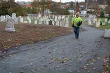 O&G employee Dave Beatty walks along the new section of the Norwalk River Valley Trail that runs through historic Pine Island Cemetery Thursday, November 16, 2017, in Norwalk, Conn. The Redevelopment Agency and Norwalk Historical Commission spearheaded the project with the agency providing capital dollars to create the new trail stretch. Resources Services of Bridgeport was awarded the $48,025 contract for the trail construction project. The company expects to complete the new trail by Nov. 1. Two trail sections will be built through Pine Island Cemetery, one compliant with the Americans With Disabilities Act, the other along a slope.