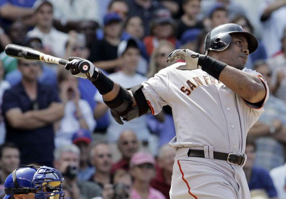 San Francisco Giants' Barry Bonds hits a three-run home run during the seventh inning of a baseball game in 2007 against the Chicago Cubs in Chicago. The cloud of steroids use will mar Bonds' achievements. Photo: M. Spencer Green /AP / AP