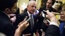 Sen. Bob Corker, who is holding hearings on the tax bill, speaks with reporters as he heads into a lunch with Senate Republicans on Capitol Hill Wednesday.