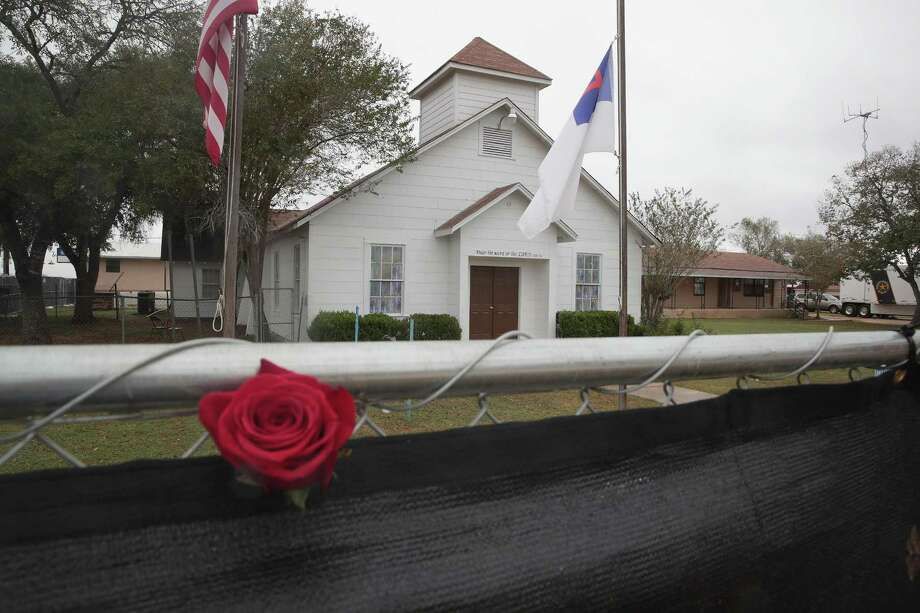 A rose is left in the fence surrounding the First Baptist Church of Sutherland Springs on Nov. 12. The congregation held its first service since the shooting that day in a tent in the towns ball park. Photo: Scott Olson /Getty Images / 2017 Getty Images
