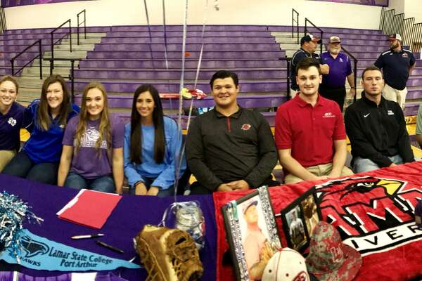 Eight athletes — four softball and four baseball — signed with universities both in and out of state during a ceremony Wednesday at the Port Neches-Groves High School competition gym.  Signing for softball were, from left: Kaitlyn Boudreaux (Stephen F. Austin University); Britni Hunt (Angelo State University); Callie Jourdan (Ouachita Baptist University); and Brooke Smith (Lamar State College-Port Arthur).  Signing for baseball were, from left: Josh Hranicky (Lamar University); Brandon Petix (Alvin Community College); Holden Lane (Texas Southern University); and Austin Bost (Panola College).  (Mike Tobias/The Enterprise)
