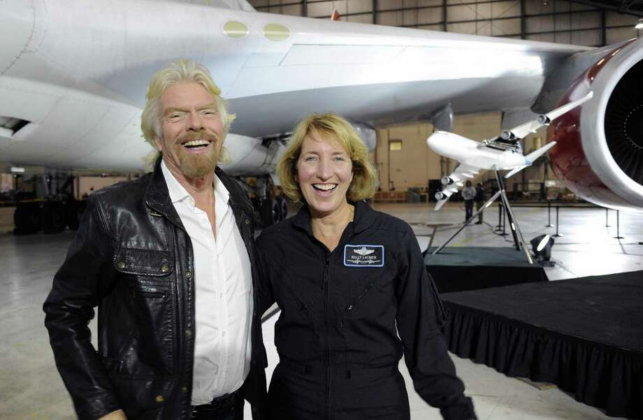 Virgin Galactic founder Richard Branson and pilot Kelly Latimer stand next to the 747-400 airplane that would be used to air launch the company's rocket. Photo: Courtesy Of Virgin Galactic / Handout