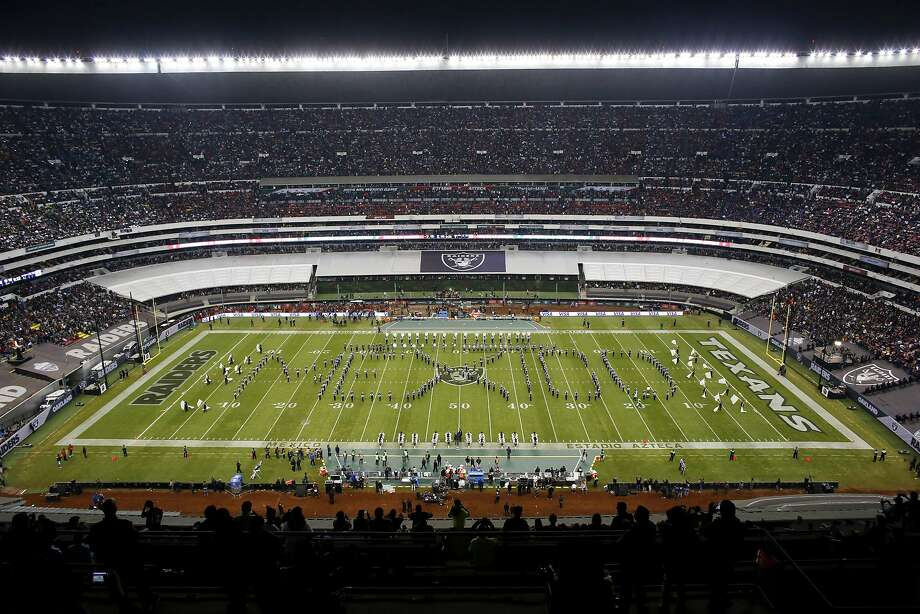 "FILE - In this Nov. 21, 2016, file photo, performers spell out ""Mexico"" during the halftime presentation at the NFL football game between the Houston Texans and the Oakland Raiders in Mexico City. The NFL's final international game this season features the back-on-target Patriots and the disappointing Raiders on Sunday. It's the second straight year Oakland has given up a game in California to host one in Mexico City. (AP Photo/Dario Lopez-Mills, File) Photo: Dario Lopez-Mills, Associated Press"
