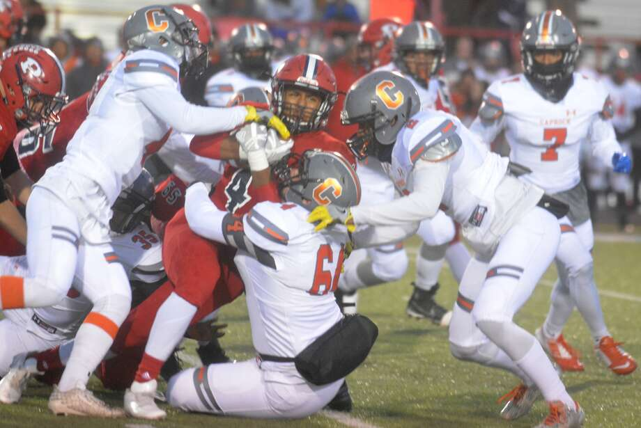 It takes three Caprock defenders to tackle Plainview running back Andrew Villa during a game earlier this season. The Bulldogs will return to the playoffs after a one-year absence when they take on Abilene Cooper in a bi-district game at 7 p.m. Friday at Frenship. Photo: Skip Leon/Plainview Herald