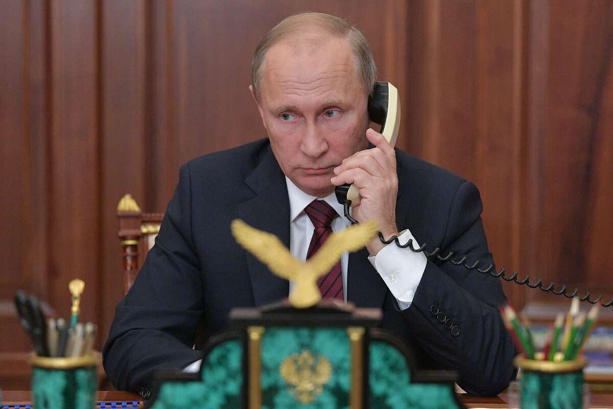 Russian President Vladimir Putin holds a telephone conversation with Alexander Zakharchenko, the leader of so-called Donetsk People's Republic, and Igor Plotnitsky, the head of the so-called Lugansk People's Republic at the Kremlin in Moscow on November 15, 2017. / AFP PHOTO / Sputnik / Alexei DruzhininALEXEI DRUZHININ/AFP/Getty Images