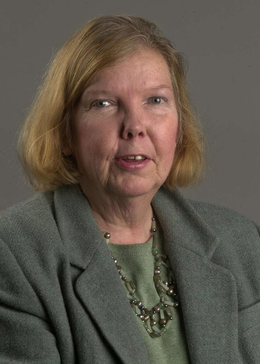 Times Union photo by Lori Van Buren Times Union book club member Julie Lomoe on February 2, 2004.