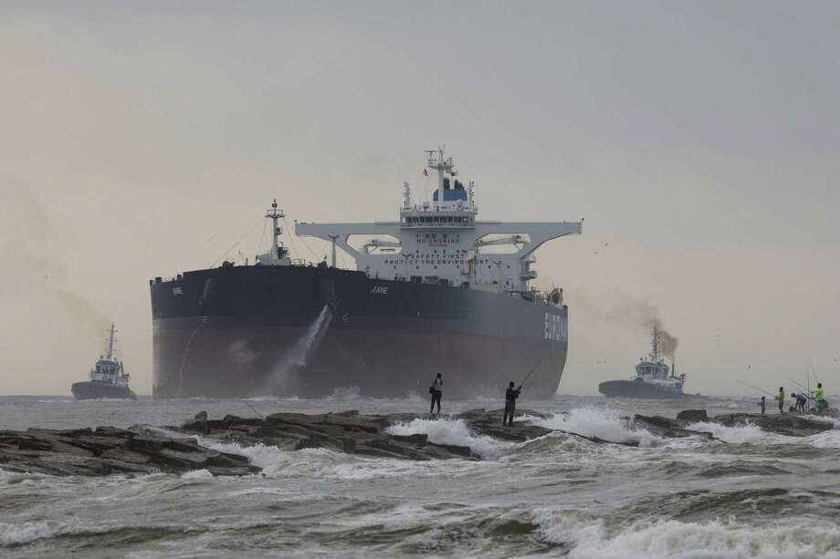 A very large crude carrier, or VLCC, approaches Occidental Petroleum Corp.'s Ingleside Energy Center Terminal near Corpus Christi. The visit marked the first time a VLCC, which can carry upwards of 2 million barrels of oil, had visited a U.S. port. The Port of Corpus Christi announced Monday that The Carlyle Group will fund the building of a VLCC-capable crude oil export terminal on Harbor Island, which sits just a few miles inland from the Gulf of Mexico. Photo: Courtney Sacco /Associated Press / Corpus Christi Caller-Times