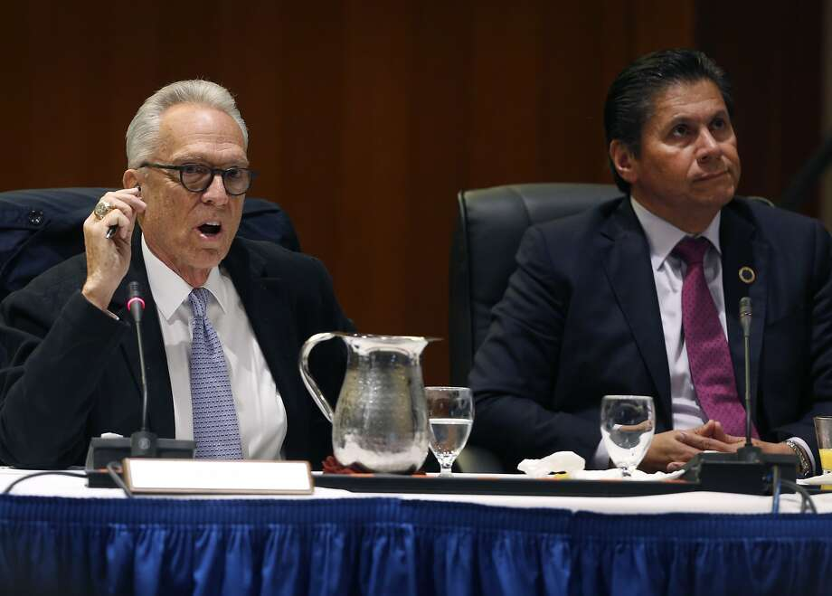 Regent Norman Pattiz (left) speaks during a meeting of the UC Board of Regents while Eloy Ortiz Oakley listens at the UCSF Mission Bay campus in San Francisco, Calif. on Thursday, Nov. 16, 2017. Photo: Paul Chinn, The Chronicle