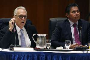 Regent Norman Pattiz (left) speaks during a meeting of the UC Board of Regents while Eloy Ortiz Oakley listens at the UCSF Mission Bay campus in San Francisco, Calif. on Thursday, Nov. 16, 2017.