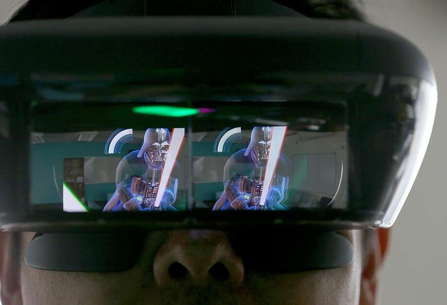Star Wars: Jedi Challenge uses augmented reality headgear and a lightsaber modeled after Rey's from Star Wars: The Last Jedi to make it seem like you're battling villains. Photo: Liz Hafalia, The Chronicle