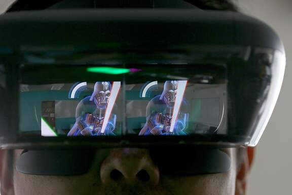 �Star Wars: Jedi Challenge�  uses augmented reality headgear and a lightsaber modeled after Rey's from Star Wars: The Last Jedi to make it seem like you�re battling villains like Darth Maulon on Thursday, November 16, 2017, in San Francisco, Calif.