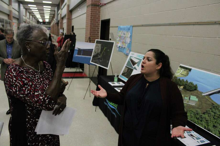 Betty Bland, left, director with Harris County Municipal Utility District No. 344, talks with Jasmin Zambrano, supervising engineer with the city of Houston, during a town hall meeting Wednesday, Nov. 15. Photo: Julie Silva