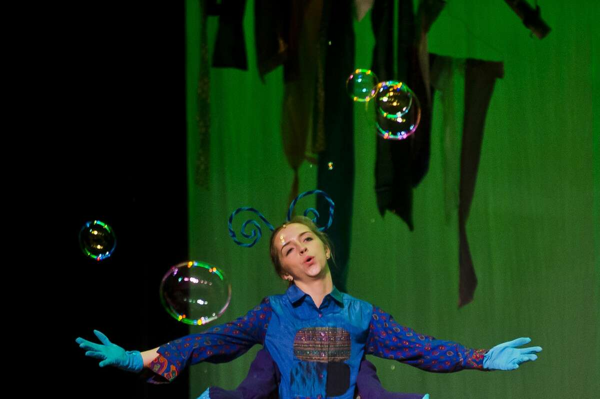 Alix Campbell, playing the role of the Caterpillar, acts out a scene during a dress rehearsal on Wednesday, Nov. 15, 2017 for H. H. Dow High School's production of Adventures in Wonderland, which opened Thursday evening and continues at 7 p.m. Friday and Saturday, with a 3 p.m. Saturday matinee. (Katy Kildee/kkildee@mdn.net)
