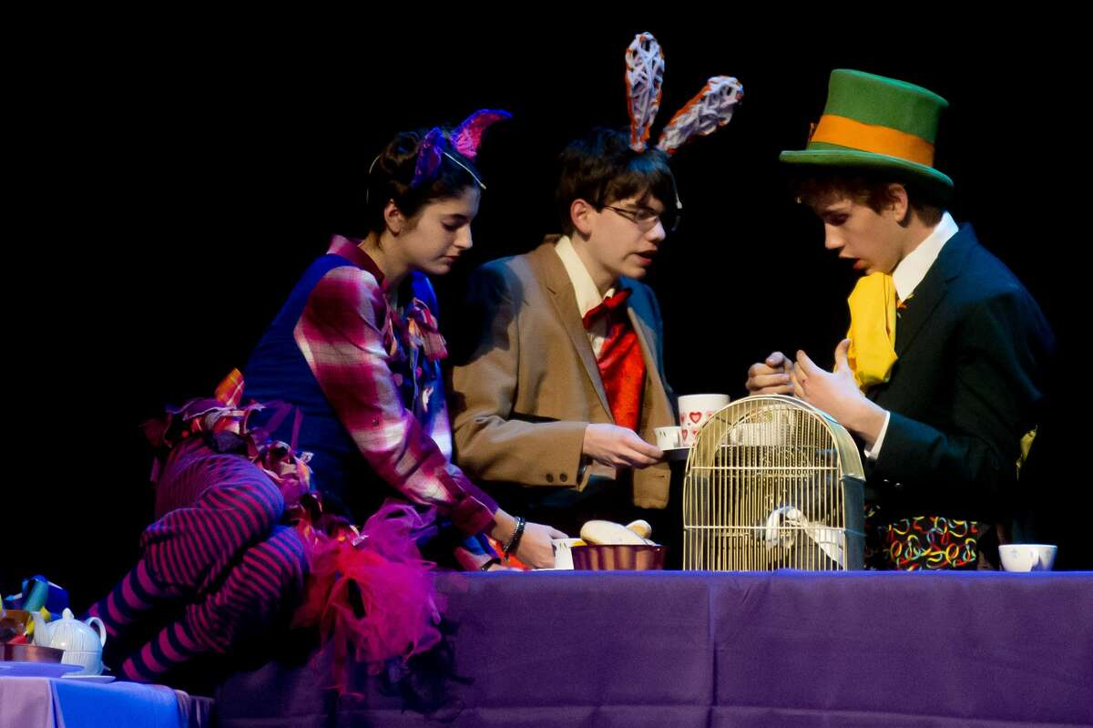 From left, Gabriella Donoso, playing the role of the Cheshire Cat, Robert Heyart, playing the role of the White Rabbit, and Stephen O'Donnell, playing the role of the Mad Hatter, act out a scene during a dress rehearsal on Wednesday, Nov. 15, 2017 for H. H. Dow High School's production of Adventures in Wonderland, which opened Thursday evening and continues at 7 p.m. Friday and Saturday, with a 3 p.m. Saturday matinee. (Katy Kildee/kkildee@mdn.net)