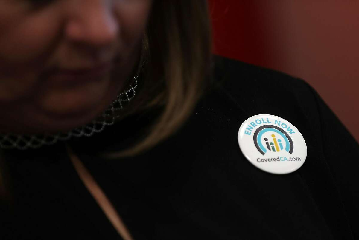 SAN FRANCISCO, CA - NOVEMBER 06: An attendee wears a button promoting open enrollment with Covered California during a news conference at HealthRIGHT 360 on November 6, 2017 in San Francisco, California. A statewide bus tour is making 22 stops throughout California to promote California Covered and encouraging people that are eligible to sign up. (Photo by Justin Sullivan/Getty Images)