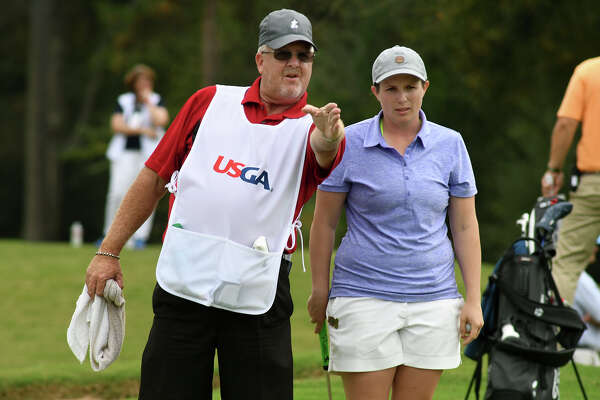 Kelsey Chugg, 26, right, of Salt Lake City, Utah, discusses her putt with caddie Chris Schuhmann, of Houston, on the par 5 13th hole during the championship match of the U.S. Women's Mid-Amateur Championship at Champions Golf Club in Houston on Thursday, Nov. 16, 2017. (Photo by Jerry Baker/Freelance)