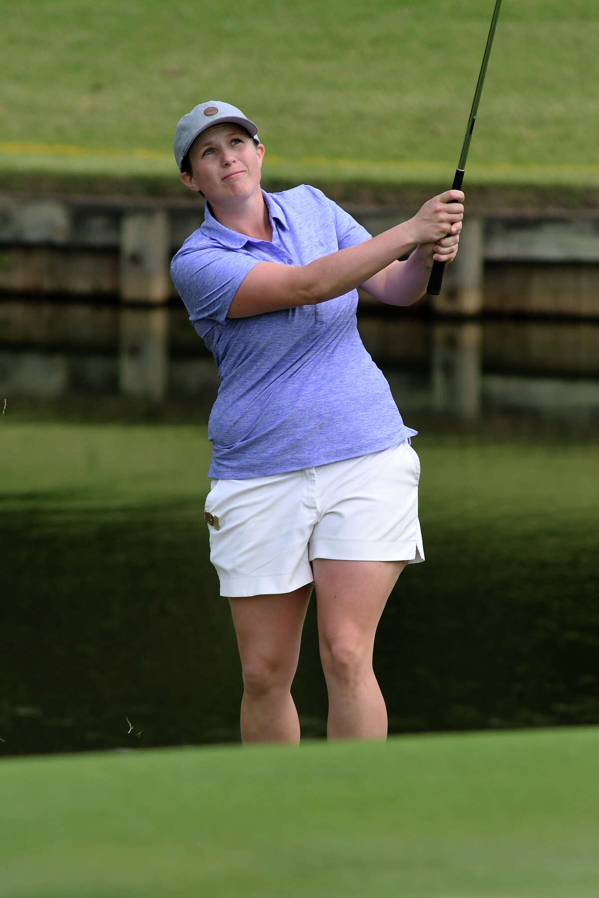 Kelsey Chugg, 26, of Salt Lake City, Utah, follows her chip shot to the green on the par 3 16th hole during the championship match of the U.S. Women's Mid-Amateur Championship at Champions Golf Club in Houston on Thursday, Nov. 16, 2017. (Photo by Jerry Baker/Freelance)