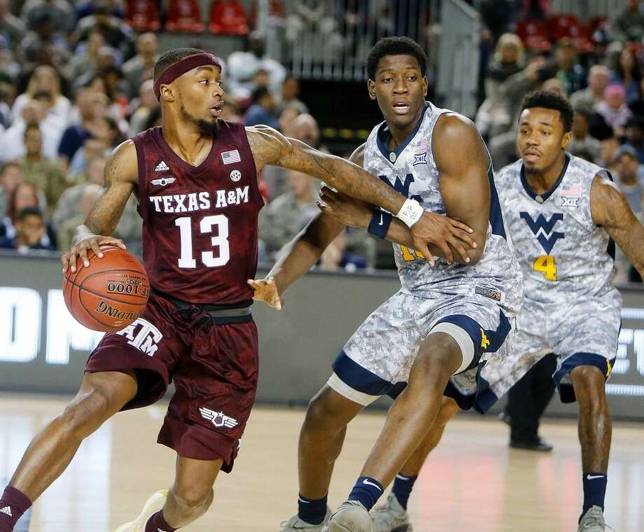 Texas A&M's Duane Wilson in action against West Virginia's Lamont West during the Armed Forces Classic between on Nov. 11, 2017 at the US Air Base in Ramstein, Germany. Photo: AP Photo /AP Photo